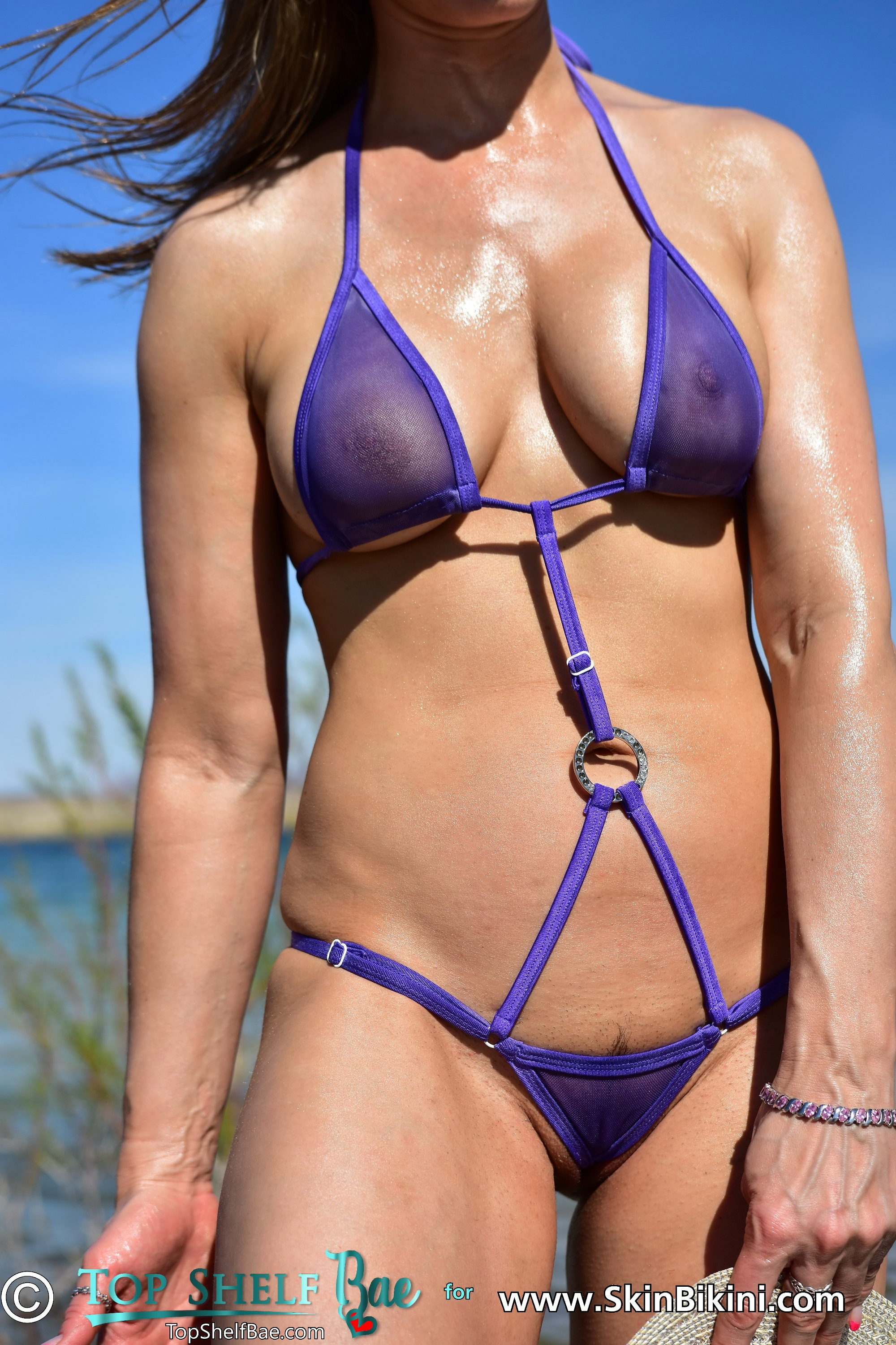 sexy model from topshelfbae is wearing skinbikini.com's hot see-thru buckled monokini in purple