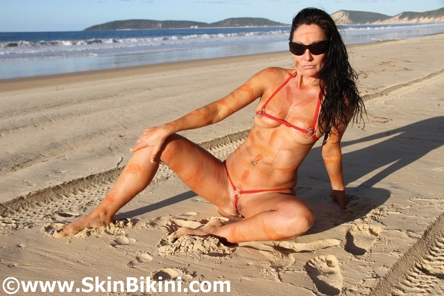 Sexy Australian girl in extreme no-coverage skin bikini
