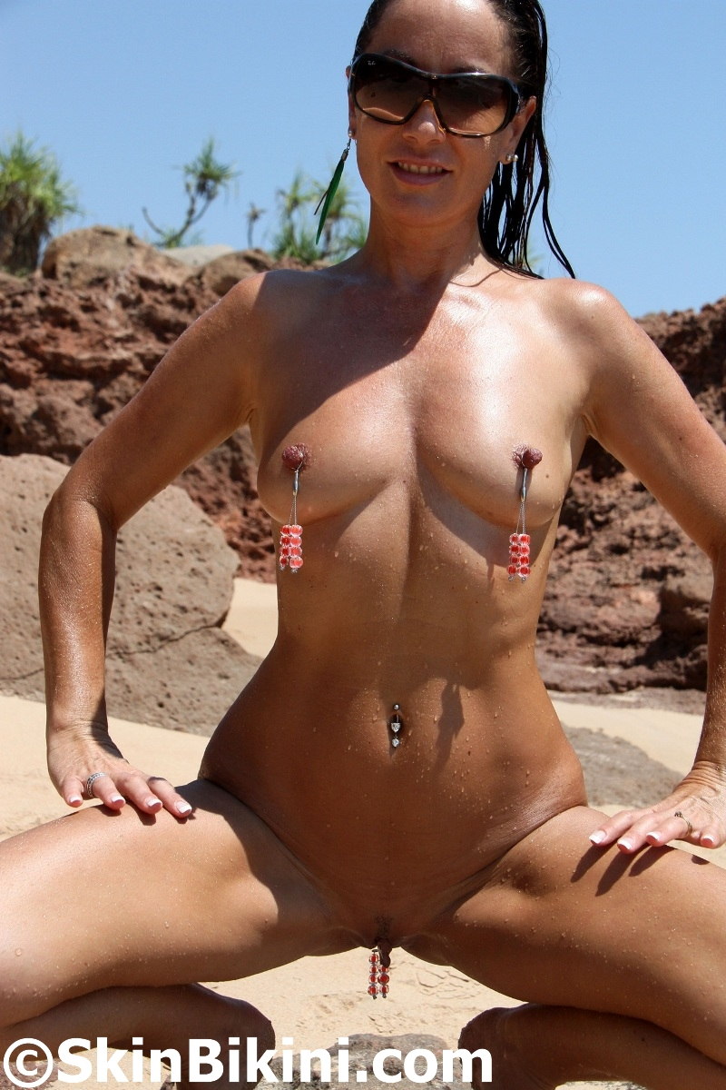 beautiful model in extreme sexy clit jewelry and nipple rings by skinbikini.com