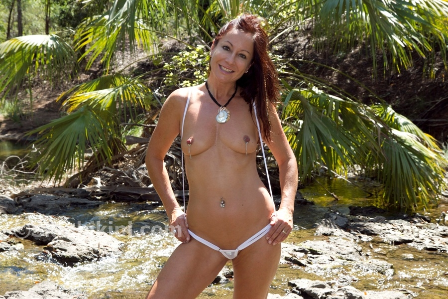 Sexy Girl in Skin Bikini non-piercing nipple rings and slingshot bikini