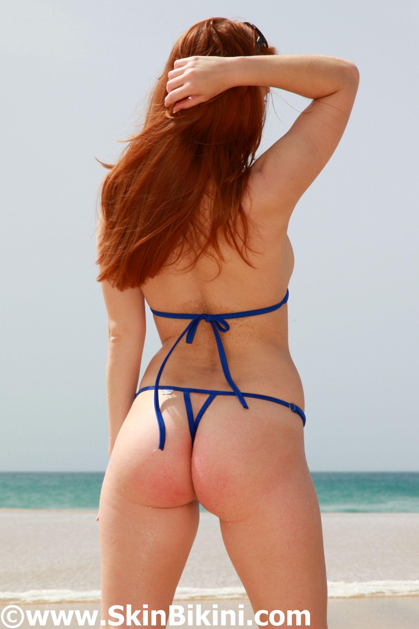 Daring SkinBikini extreme crotchless micro bikinii worn by Bikini-Dare Model